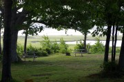 Nice shaded camping spot by the river at Pictou