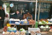 Market stall, also selling the bundles of seaweed (in the crate at the back)